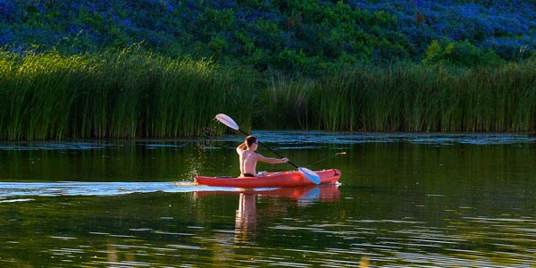 Photo of a kayaker on Holmes Lake.