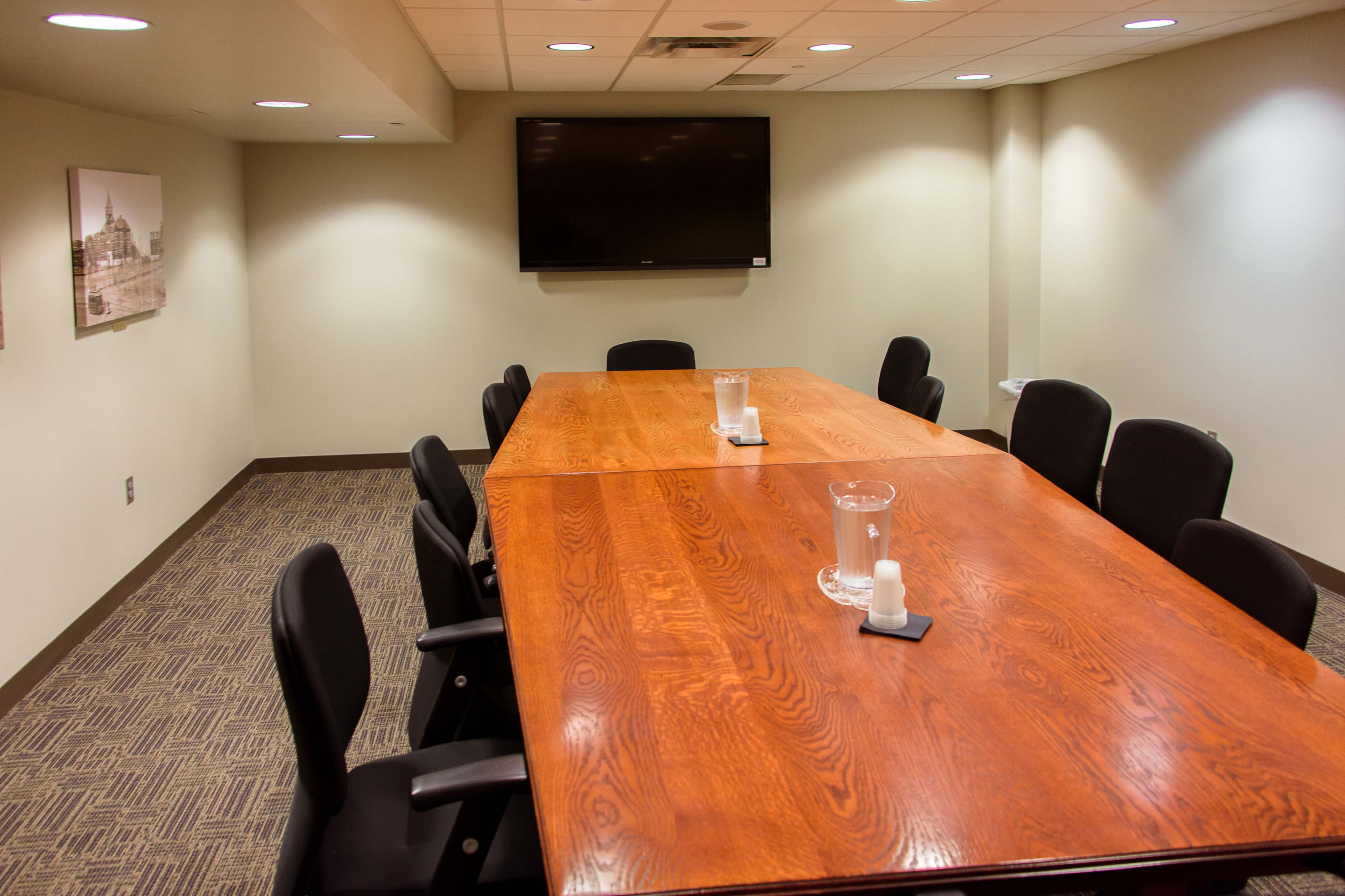 A straightforward view of the Hagen Conference Room showcasing its table and TV setup