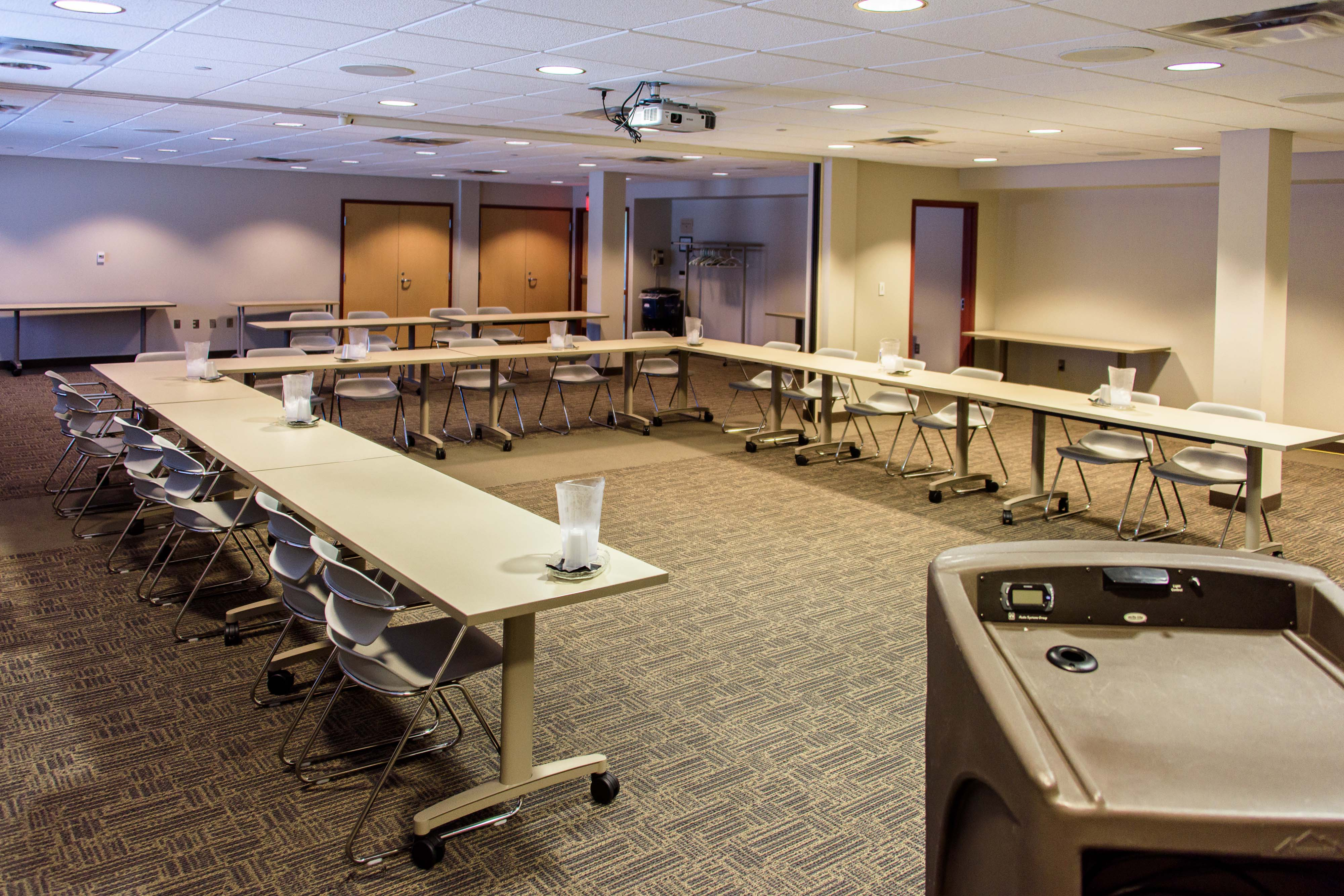 A view of the tables and seating in the Shawnee-Porter Care Conference Room from behind a podium