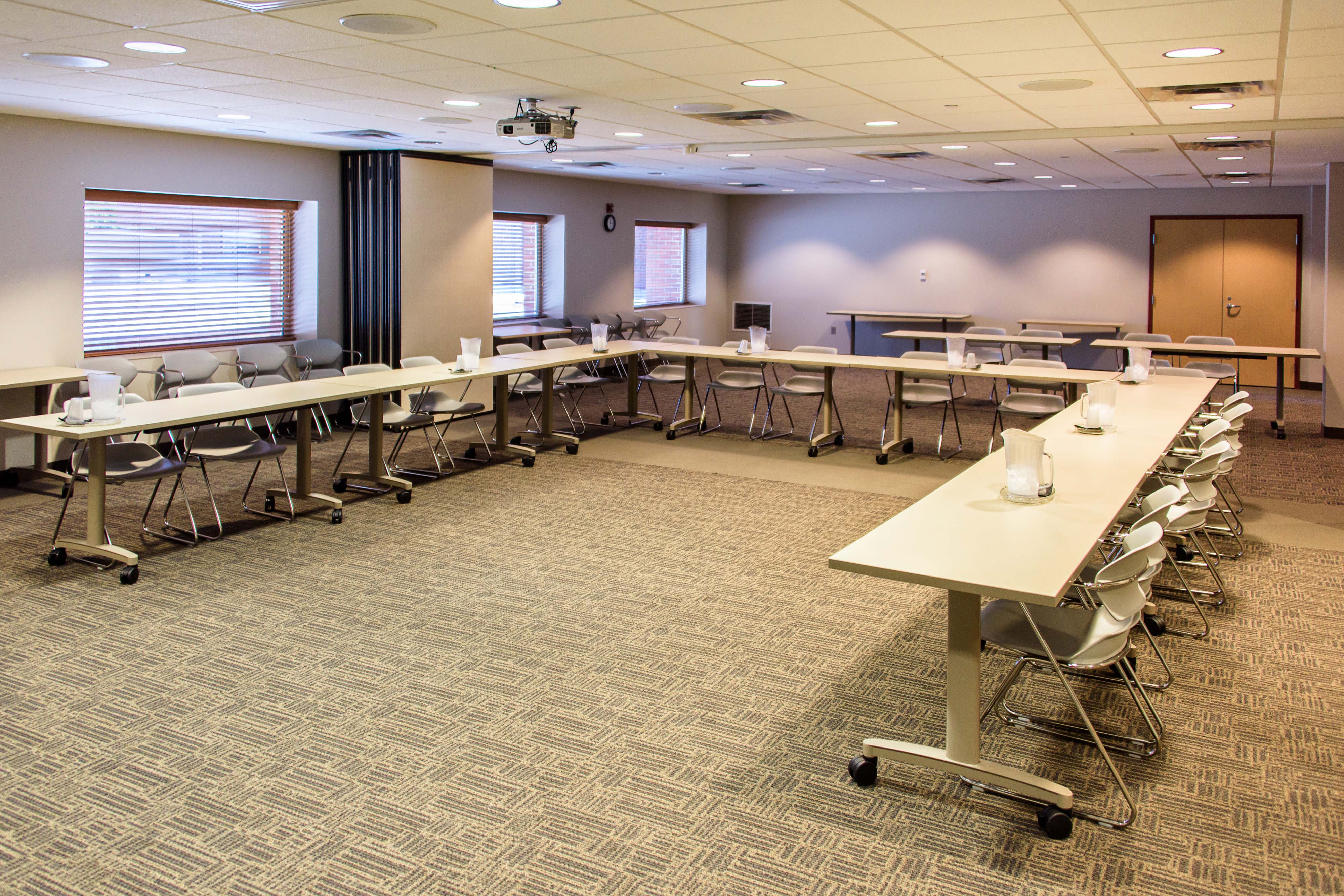 An angle showcasing the tables and seating in the Shawnee-Porter Care Conference Room