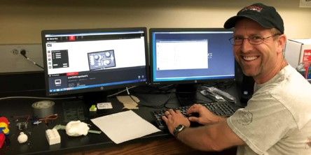 The engineering professor, Dr. Seth McNeil, working on 3D models in CAD
